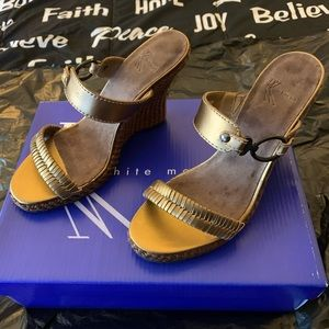 Gold wedge slip on sandals size 7.5.